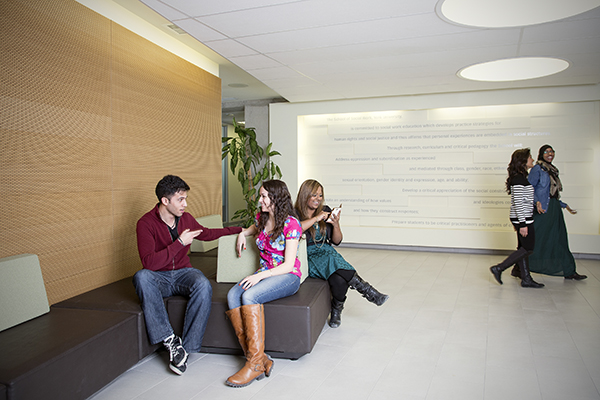 photo of students in the School of Social Work lobby